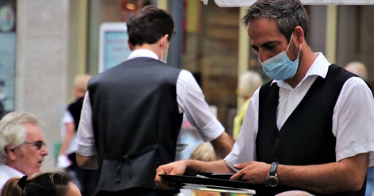 Waiters wearing masks